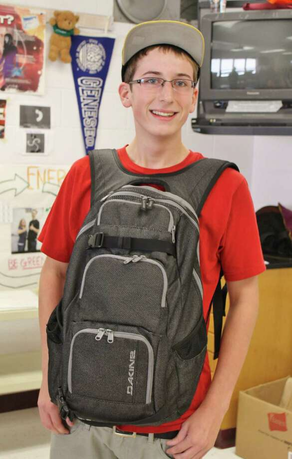 "High School junior Collin Goodman poses with his backpack positioned in the new, ""cool"" fashion. Photo by Alex Luciano. Photo: New Visions: Journalism & Media Studies"