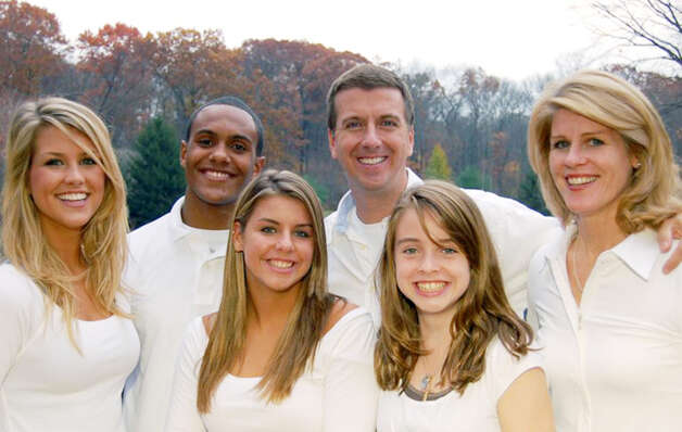 Marcus Dixon with his adopted family, Erin, Lauren, Kelley and Rose  and Barry McInerne. Photo: Contributed Photo / Stamford Advocate contributed