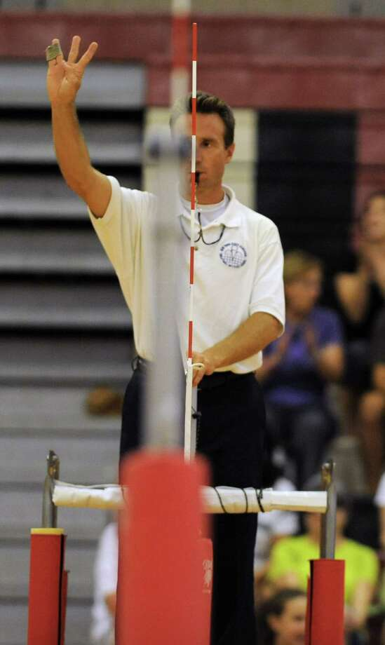 The up ref shows the signal for ball contacted more than three times by a team during a volleyball match with Guilderland vs. Shenendehowa Thursday, Sept. 13, 2012 in Guilderland, N.Y. (Lori Van Buren / Times Union) Photo: Lori Van Buren
