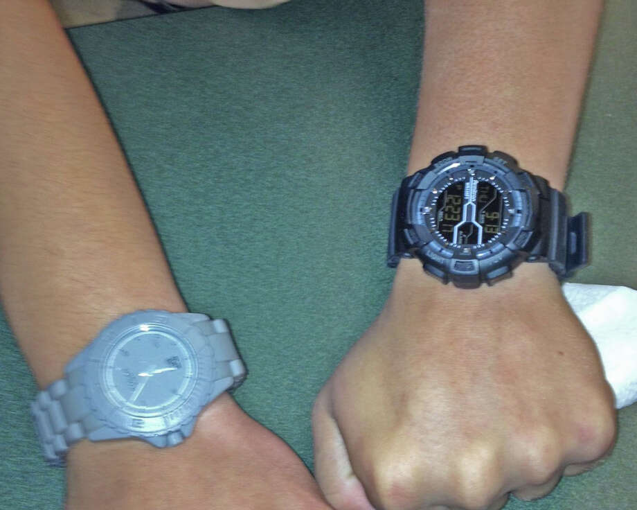 Schalmont High School 12th graders compare new watches during lunch. Photo by Ryan Wintle. Photo: New Visions: Journalism & Media Studies