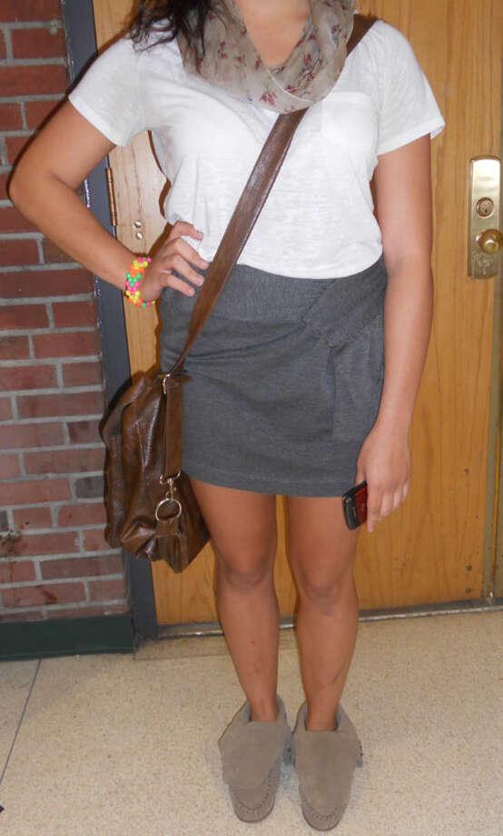 Miriam Galarza, a 12th grader at Schalmont High School, wears a white v-neck tee tucked into a gray cotton mini-skirt, paired with a floral scarf and tan boots. Photo by Rosa D'Ambrosio. Photo: New Visions: Journalism & Media Studies