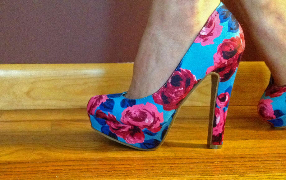 Trying on a new floral print chunky heel. Photo by Erik DeFruscio. Photo: New Visions: Journalism & Media Studies