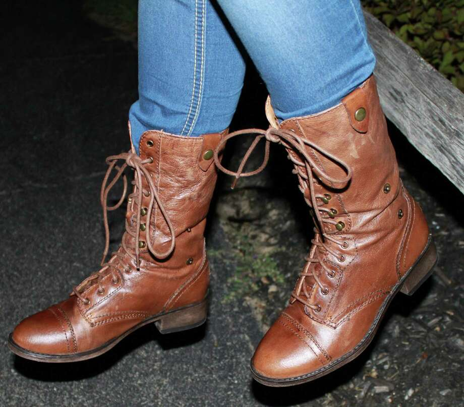 Brown high-laced boots create great fall fashion, while keeping the wearer warm. Photograph by Chris Amorosi. Photo: New Visions: Journalism & Media Studies
