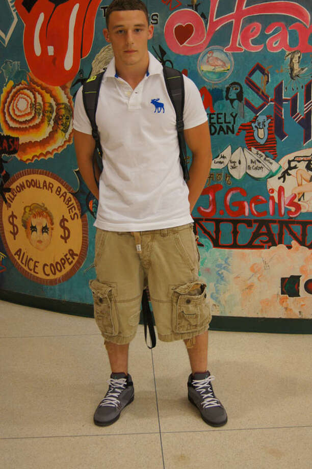 Anthony Paturso, a 12th grader at Schalmont High School, wears a white polo and cargo shorts. Photo by Rosa D'Ambrosio. Photo: New Visions: Journalism & Media Studies