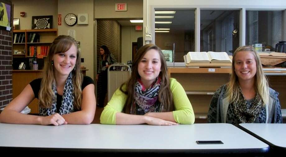 Middleburgh Central seniors Brianna Kingsbury, Aubrey Scotti, and Brittany Nelson (from left to right), all wear fashionable animal print scarves. Photo by Ariella Phillipo. Photo: Picasa, New Visions: Journalism & Media Studies