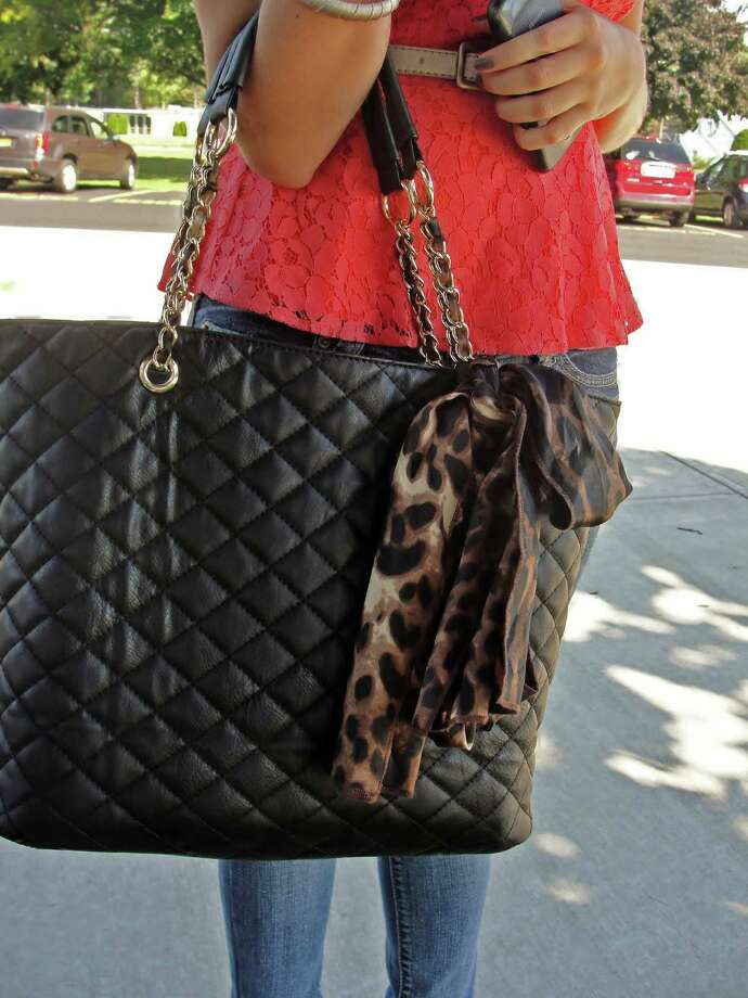 Quilted bags with chain straps are growing in popularity. This particular bag also features a leopard print silk bow. Photo by Amanda Pellegrin. Photo: New Visions: Journalism & Media Studies