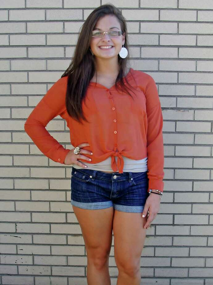 Giovanna Giovannone, a Scotia-Glenville senior, showing off her tied orange button up blouse and flashy gold jewelry. Photo by Amanda Pellegrin. Photo: New Visions: Journalism & Media Studies