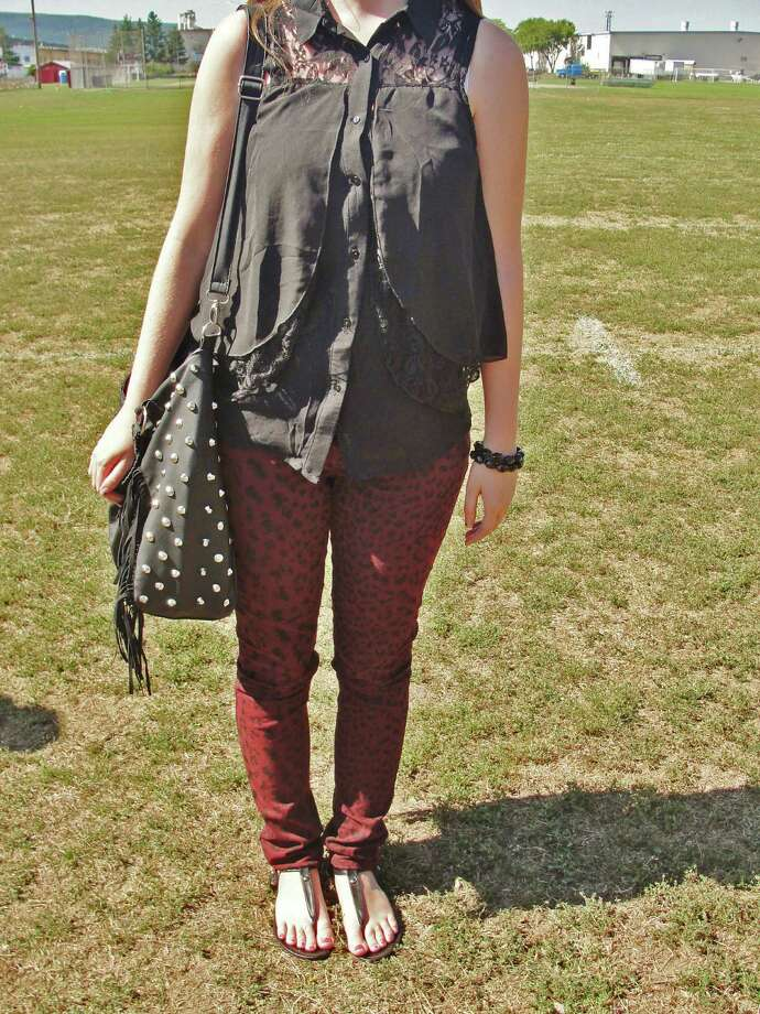 Sydney Barnes, a Scotia-Glenville senior, wearing red and black cheetah print pants and a black button up tank-top with lace layering. Photo by Amanda Pellegrin. Photo: New Visions: Journalism & Media Studies