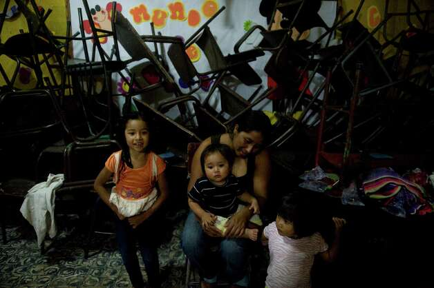 People evacuated from Morelia in Chimaltenango sit in a shelter in a public school of Santa Lucia Cotzumalguapa, Escuintla department, 90 kilometers south of Guatemala City, on Thursday after their village was affected by columns of ash released by the Volcan de Fuego. Guatemala's Volcano of Fire had its strongest eruption in a decade on Thursday, prompting the evacuation of around 33 thousand people, officials announced. The eruption created massive columns of smoke that could be seen from the capital, some 75 kilometers away. (JOHAN ORDONEZ/AFP/GettyImages) Photo: JOHAN ORDONEZ, Ap/getty / 2012 AFP