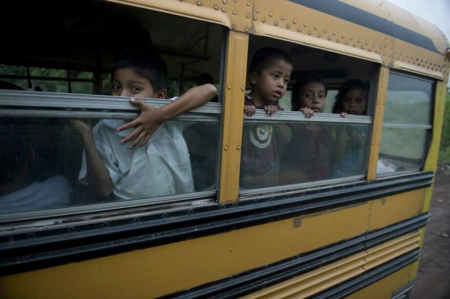 Children are being evacuated from Morazan in Chimaltenango department, 125 kilometers south of Guatemala City on Thursday in a bus, after the village was affected by columns of ash released by the Volcan de Fuego. Guatemala's Volcano of Fire had its strongest eruption in a decade on Thursday, prompting the evacuation of around 33 thousand people, officials announced. The eruption created massive columns of smoke that could be seen from the capital, some 75 kilometers away. (JOHAN ORDONEZ/AFP/GettyImages) Photo: Ap/getty