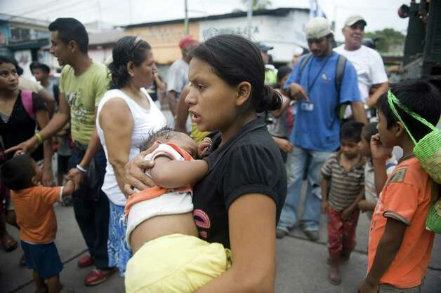 People evacuated from Morazan in Chimaltenango department, arrive at a shelter in a public school of Santa Lucia Cotzumalguapa, Escuintla department, 90 kilometers south of Guatemala City, on Thursday after their village was affected by columns of ash released by the Volcan de Fuego. Guatemala's Volcano of Fire had its strongest eruption in a decade on Thursday, prompting the evacuation of around 33 thousand people, officials announced. The eruption created massive columns of smoke that could be seen from the capital, some 75 kilometers away. (JOHAN ORDONEZ/AFP/GettyImages) Photo: JOHAN ORDONEZ, Ap/getty / 2012 AFP