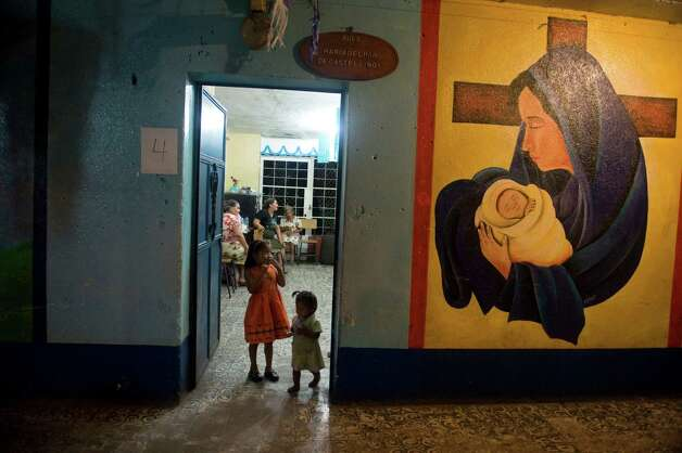 Two girls from Morelia in Chimaltenango sit in a shelter in a public school of Santa Lucia Cotzumalguapa, Escuintla department, 90 kilometers south of Guatemala City, on Thursday after their village was affected by columns of ash released by the Volcan de Fuego. Guatemala's Volcano of Fire had its strongest eruption in a decade, prompting the evacuation of around 33,000 people, officials announced. The eruption created massive columns of smoke that could be seen from the capital, some 75 kilometer away.  (JOHAN ORDONEZ/AFP/GettyImages) Photo: JOHAN ORDONEZ, Ap/getty / 2012 AFP