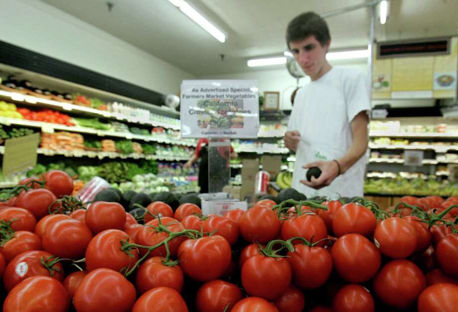 Cluster tomatoes are seen in the foreground as Ethan Larson shops for avocados at Compton's market in Sacramento, Calif., Friday, July 18, 2008. In Virginia is there is a bumper crop of tomatoes, but there is a lingering consumer concern about the safety of tomatoes. Photo: Rich Pedroncelli, AP / AP