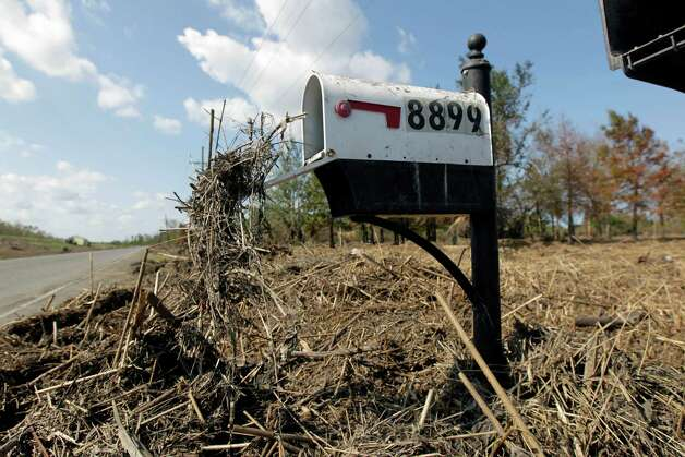 Marsh grass hangs out of a mailbox after floodwaters from Hurricane Isaac receded in Braithwaite, La., Thursday, Sept. 6, 2012.  Isaac hit southeast Louisiana and coastal Mississippi last week, causing severe flooding and seven deaths. (AP Photo/Gerald Herbert) Photo: Gerald Herbert, STF / AP