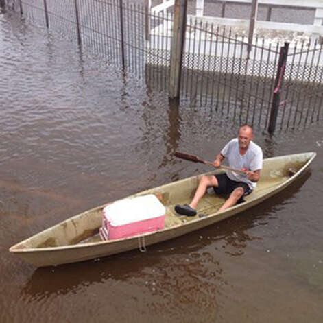 Guy rides in a canoe in a foot of water during Gov. Romney tour of Hurricane Isaac flooding in La. #aponthetrail (AP Photo/Evan Vucci) Photo: Evan Vucci, STF / AP