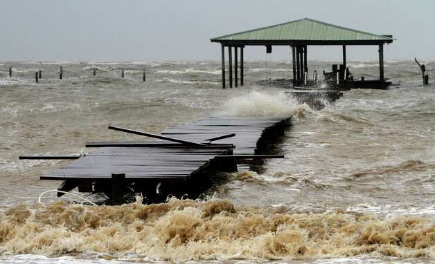 FILE - This Aug. 28, 2012 file photo shows waves caused by Hurricane Isaac tearing apart a pier along the Mobile Bay in Coden, Ala., near Dauphin Island. Gov. Robert Bentley has asked the president for federal assistance to help with damage caused by the hurricane. The governor's initial request covers Baldwin, Mobile and Pickens counties, but the Alabama Emergency Management Agency says preliminary damage assessments are continuing in other counties. A public assistance declaration  by the president would provide help with debris removal, emergency protective measures, and the repair, replacement or restoration of publicly owned facilities and the facilities of some nonprofit organizations. (AP Photo/Butch Dill, file) Photo: Butch Dill, FRE / FR111446 AP