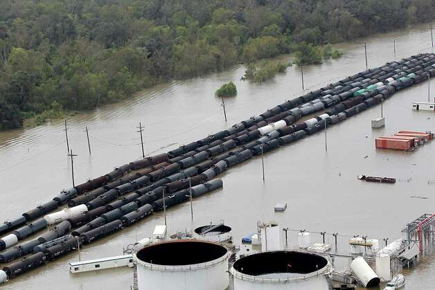 In this Aug. 30, 2012 photo, flooded railcars and storage tanks are seen at the Stolthaven Braithwaite LLC chemical storage facility in Braithwaite, La., in the aftermath of Hurricane Isaac. State officials are investigating how many chemicals leaked from storage tanks at a facility flooded by Hurricane Isaac. Rodney Mallett, a spokesman with the Louisiana Department of Environmental Quality, said crews were working to clean up the facility Thursday, more than two weeks after Isaac struck Louisiana. (AP Photo/Gerald Herbert) Photo: Gerald Herbert, STF / AP