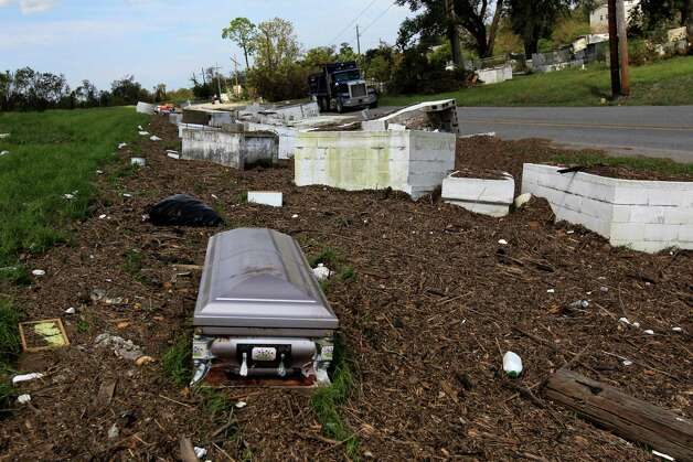 Graves from an upturned cemetery sit on the levee after floodwaters receded in Braithwaite, La., in the aftermath of Hurricane Isaac, Tuesday, Sept. 4, 2012. The full scope of the damage Hurricane Isaac left behind in Louisiana isn't yet known as people are finally getting back into the hardest-hit areas to clean up and take a look at what they've lost. (AP Photo/Gerald Herbert) Photo: Gerald Herbert, STF / AP