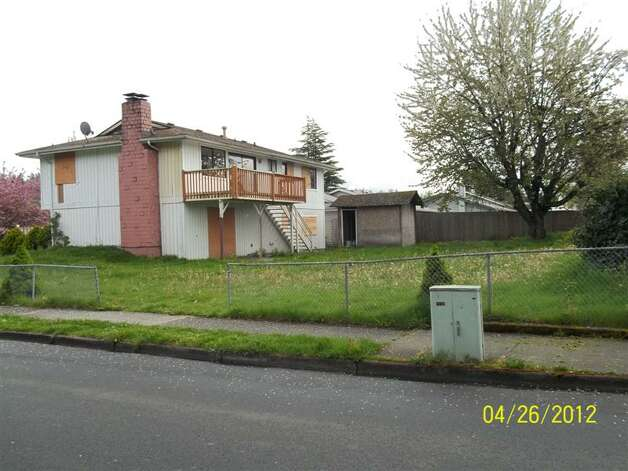 "A photo of a neglected lender-owned home from Auburn's ""Wall of Shame."" Photo: City Of Auburn"