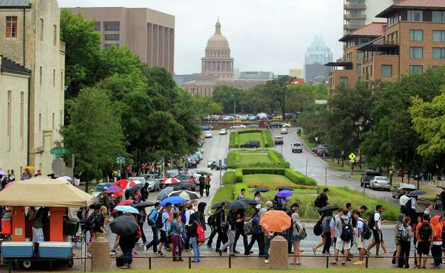 University of Texas students evacuate campus after the university received a bomb threat Friday morning, Sept. 14, 2012 in Austin, Texas. The university received a call about 8:35 a.m. local time from a man claiming to be with al-Qaida who said he had placed bombs all over the 50,000-student Austin campus, according to University of Texas spokeswoman Rhonda Weldon. Photo: AP Photo/Statesman.com,  Ricardo B. Brazziell / Statesman.com