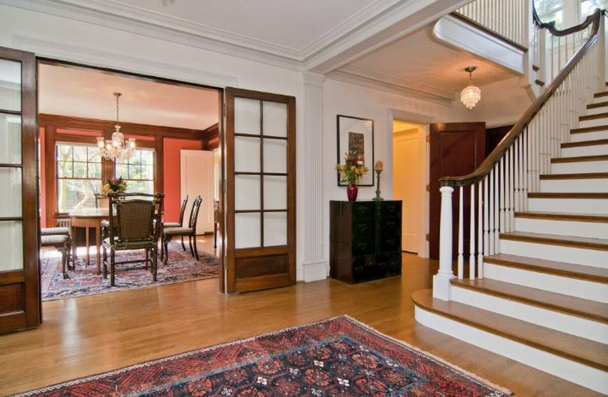 Entry of 1233 21st Ave. E. The 4,220-square-foot sideways Colonial, built in 1920, has four bedrooms and 2.25 bathrooms -- including a master suite with a fireplace and deck -- exposed wood moldings and doors, a sun room and a patio with an outdoor fireplace on a 6,900-square-foot lot. It's listed for $1.99 million.