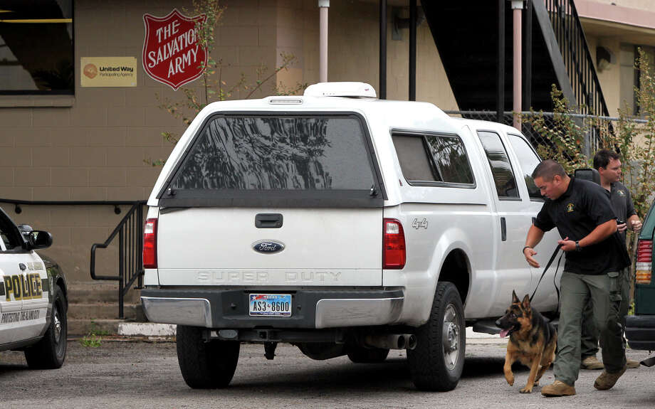 A member of the San Antonio Police Department's bomb squad makes a sweep with a dog at the Salvation Army after a bomb threat was made at its location at 226 Nolan Street Friday September 14, 2012. The call came in at about 8:00 a.m. and the all clear was given by police at 9:40 a.m. . Photo: John Davenport / Express-News