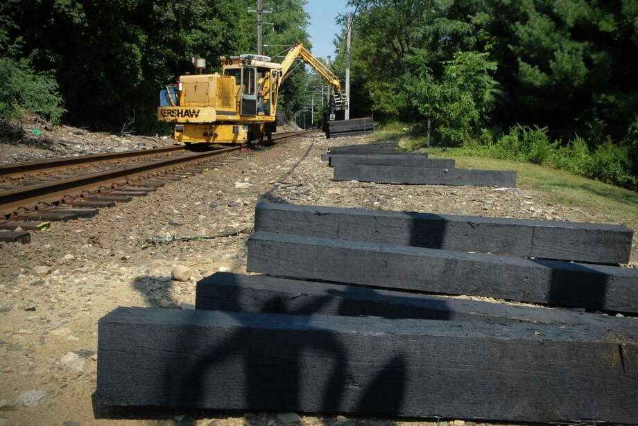Metro North employees replace rotted railroad ties on the New Canaan line in Stamford, Conn. on Friday September 14, 2012. Photo: Dru Nadler / Stamford Advocate Freelance