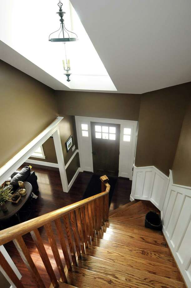 The stairway of a model home, which serves as an office, on Wednesday, May 30, 2012, at Wolfe Builders and Wolfe Modular Homes in Coxsackie, N.Y. The home is a modular home with builder details. (Cindy Schultz / Times Union) Photo: Cindy Schultz / 00017827A