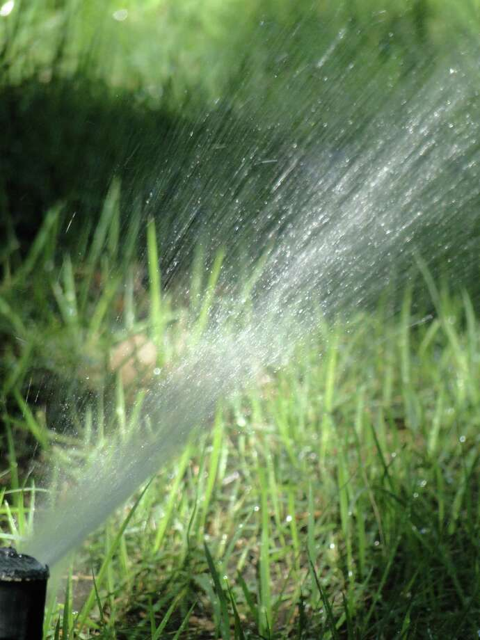 Liberalized Stage 2 restrictions would allow homeowners to use lawn sprinklers for a longer period of time. Photo: Express-News File Photo, STAFF / TLEHMANN@EXPRESS-NEWS.NET