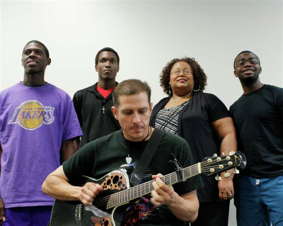 "Kenneth Hemmans (from left), Michael Chambers, Ryan McGuire, Marsha P. Hall and Glen Scallion appear in ""The Ballad of Emmitt Till."""