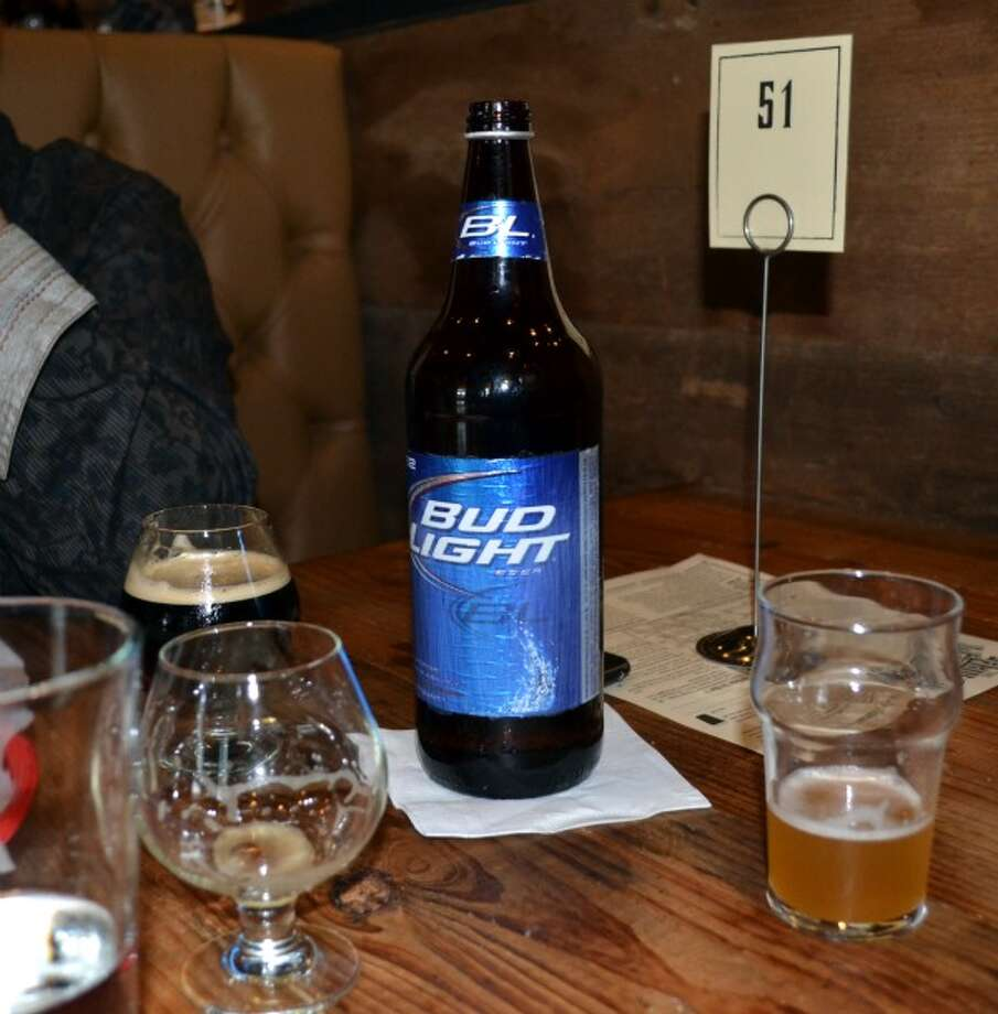 Yes, that is a Bud Light bottle. But it is filled with water. Floyd bought six cases of 40-ounce Bud and Bud Lights, poured out the beer and uses them for water service. (Ronnie Crocker / Beer, TX)