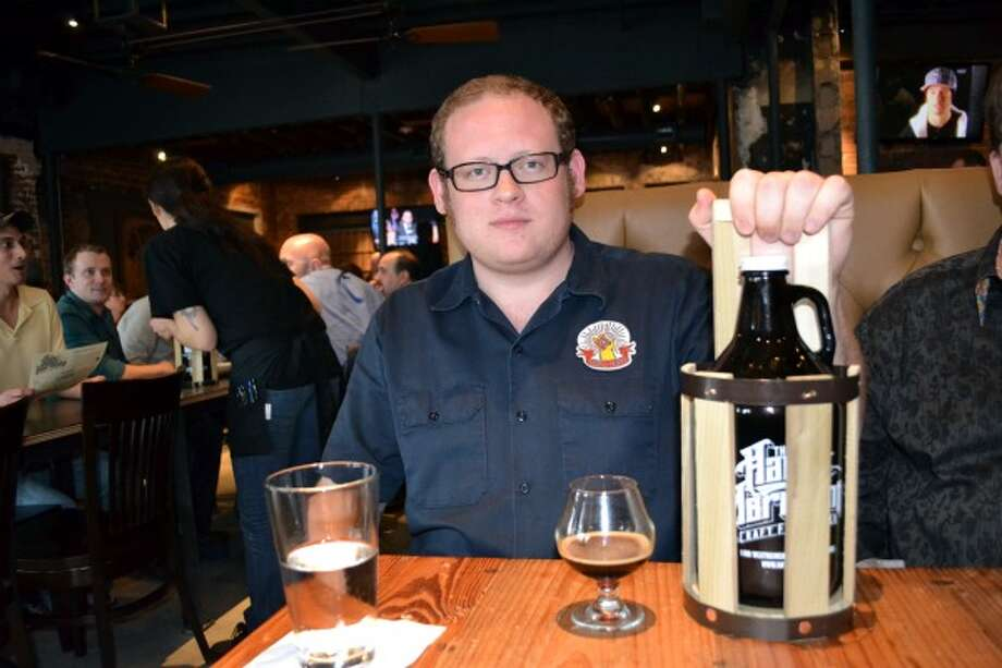 Kyle White was one of the first 100 people to buy a growler. That meant he got the cool wooden carrying case. (Ronnie Crocker / Beer, TX)