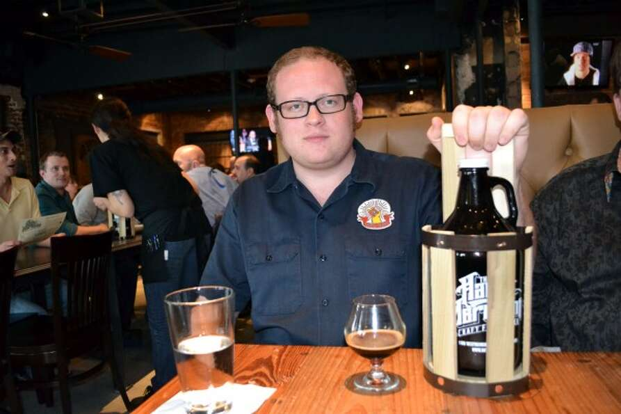 Kyle White was one of the first 100 people to buy a growler. That meant he got the cool wooden carry
