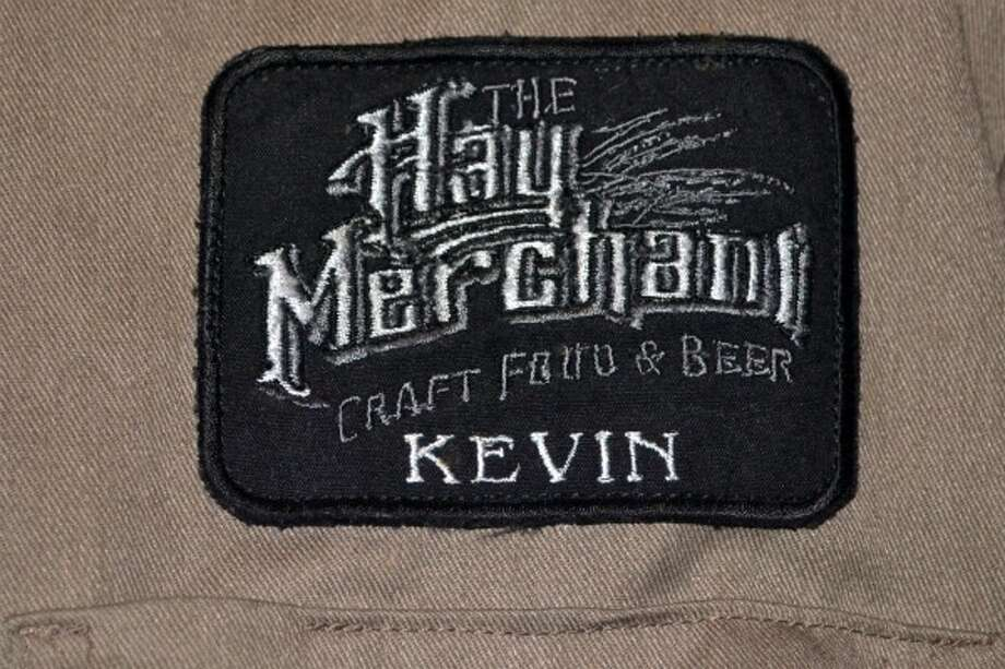 Kevin Floyd's mom turned a Dickies work shirt into an official Hay Merchant shirt for the staff. (Ronnie Crocker / Beer, TX)