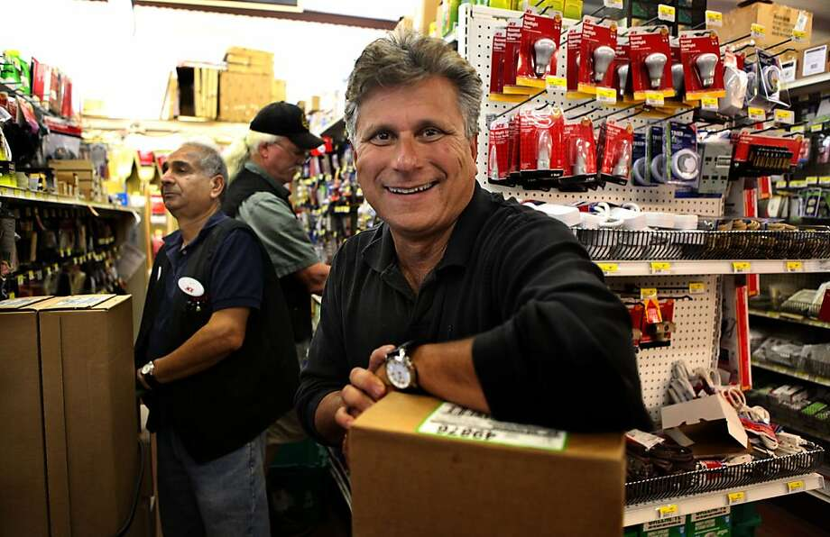 After a career in TV news, Jim Wieder owns Ace Hardware in Hayward, above, where he helps a customer, below, load his car. Photo: Liz Hafalia, The Chronicle