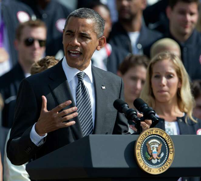President Barack Obama speaks on the South Lawn of the White House in Washington, Friday, Sept. 14,