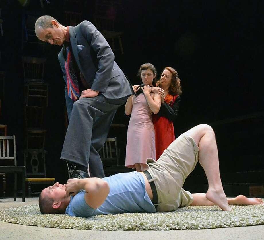 Man (Richard Aiello) and Woman (Linda Ayres-Frederick) get rough with Boy (Shane Rhoades) and Girl (Anya Kazimierski). Photo: Jay Yamada