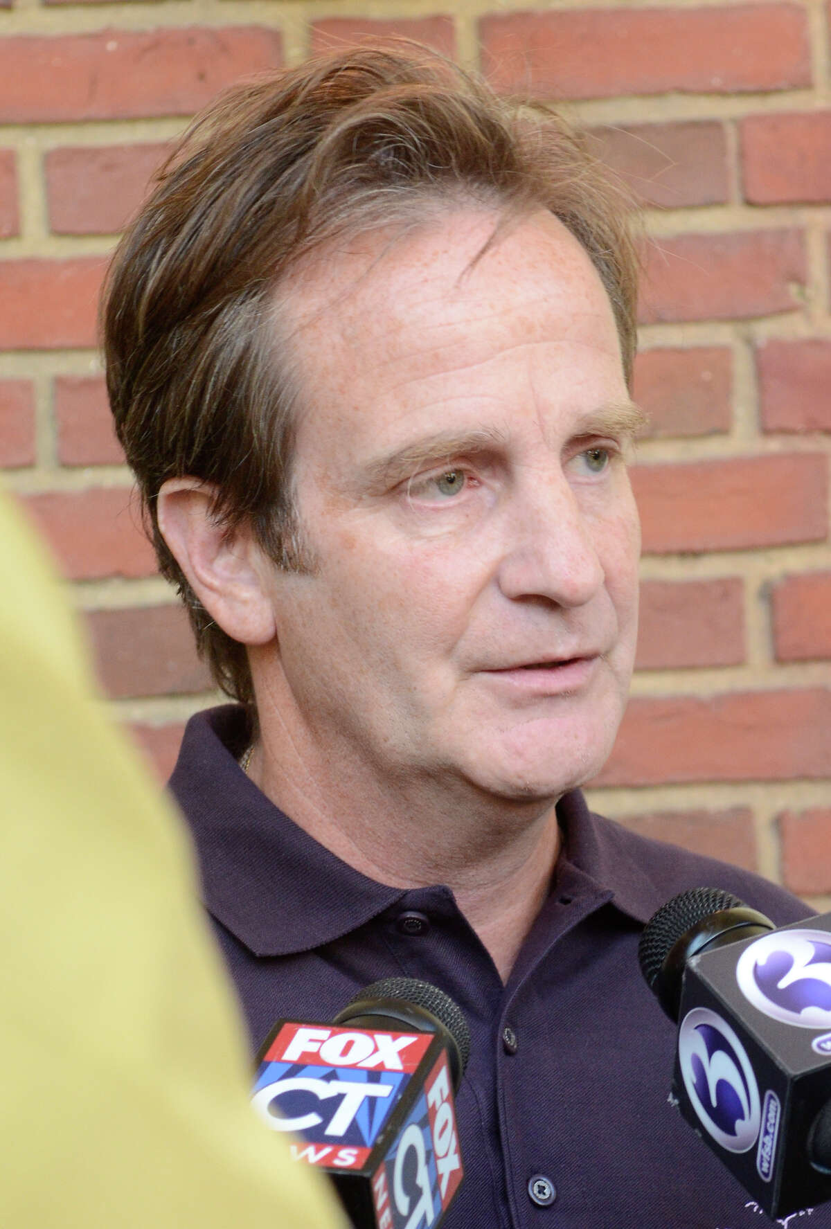 Matthew Badger speaks to reporters outside the Manice Lockwood Mansion in Norwalk, CT. Badger spoke at a benefit there later to raise funds to support the arts in Norwalk schools, through the LilySarahGrace Fund, on Sept. 13, 2012. The LilySarahGrace Fund was founded in honor of Lily, Sarah and Grace Badger who lost their lives last year in a Christmas day fire at their home in Stamford, CT. Thursday's benefit event, called Art 'n Bloom, showcased the art of 13 Norwalk artists, all of whom are members of St. Philip Artists Guild.