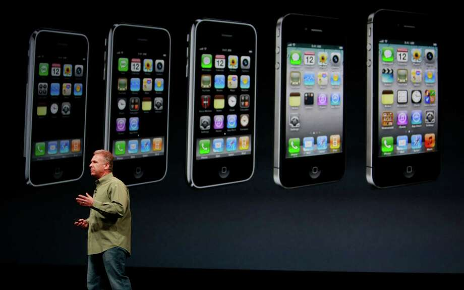 On Sept. 12, Apple announced the iPhone 5. It touts a new 4-inch Retina display, faster A6 chip, iOS 6 operating system, 4G LTE support and an aluminum body that's just 7.6 millimeters thick. Photo: Mike Kepka, The Chronicle / ONLINE_YES