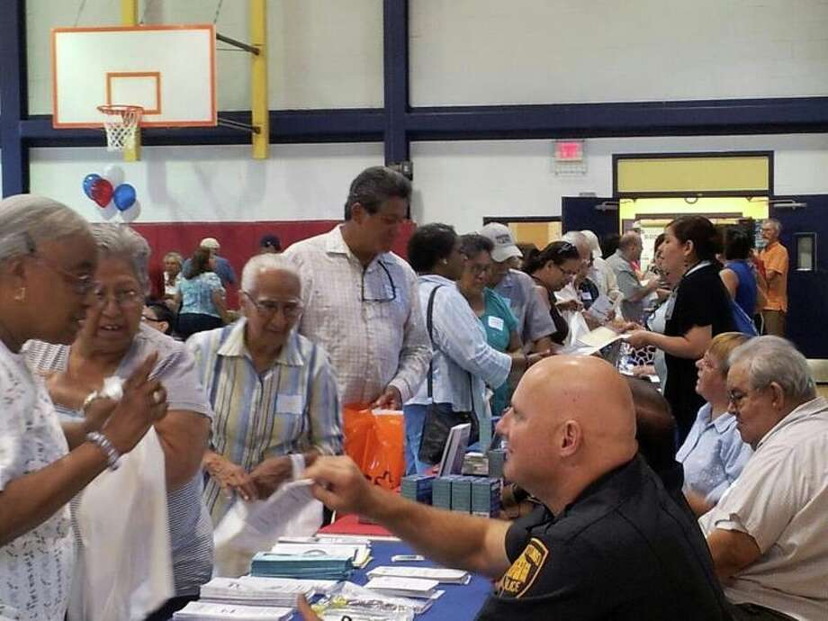 San Antonio Police Department Patrolman David Nouhan (right) chats with members of the community at the District 3 Patriot Day Senior Health Fair on Sept. 11. Photo: Courtesy Photo