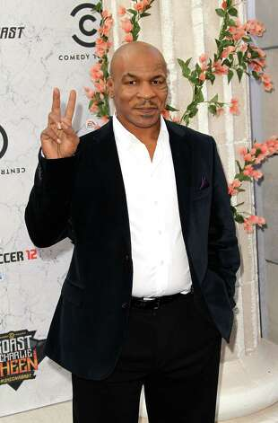 Former professional boxer and The Hangover actor Mike Tyson became a vegan because of a family history of obesity. He reportedly lost over 100 pounds after making the change. Photo: Frederick M. Brown, Getty Images / 2011 Getty Images