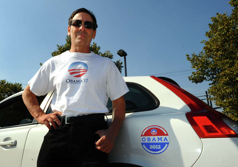 Robert Kavitz poses at the Pilot Travel Center in Milford, Conn. on Friday September 14, 2012. On Thursday, While pumping gas, Kavitz was verbally abused and threatened by a man for wearing his Obama 2012 T-shirt. Photo: Christian Abraham / Connecticut Post