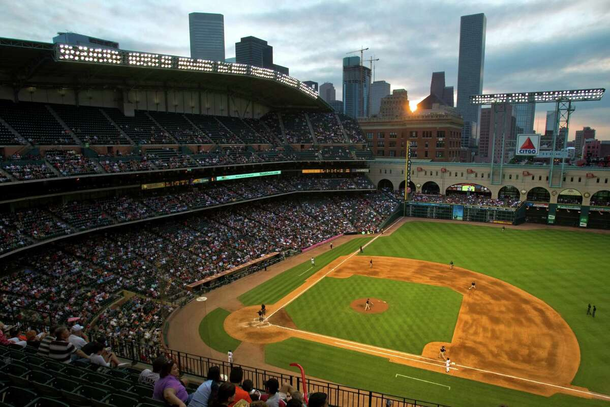 The sun sets over the downtown skyline during an Astros game at Minute Maid Park. The team will play in Major League Baseball's American League next season.