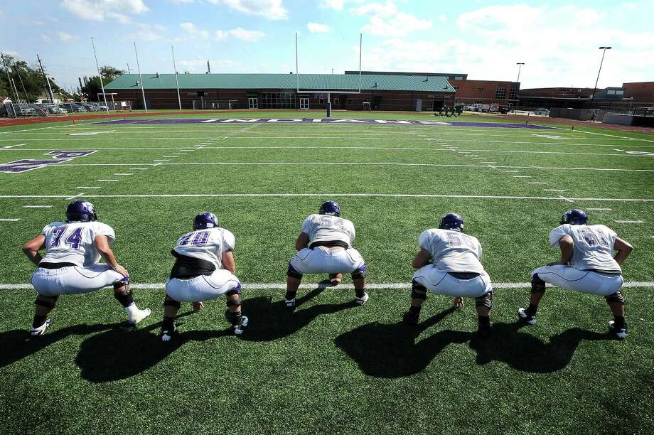 Port Neches-Groves offensive lineman Justin Reasons, Aaron Orozco, Allan Soriano, Chris Mangini and Hunter Hanratty find their positions on the field at PN-G High School. Photo taken: Randy Edwards/The Enterprise