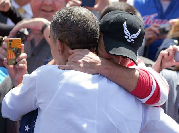 President Barack Obama embraces U.S. Air Force member Ricky D. Watson of Littleton, Colo., during a campaign event at Lions Park, Thursday, Sept. 13, 2012, in Golden,  Colo. (AP Photo/Carolyn Kaster) Photo: Carolyn Kaster, Associated Press / AP