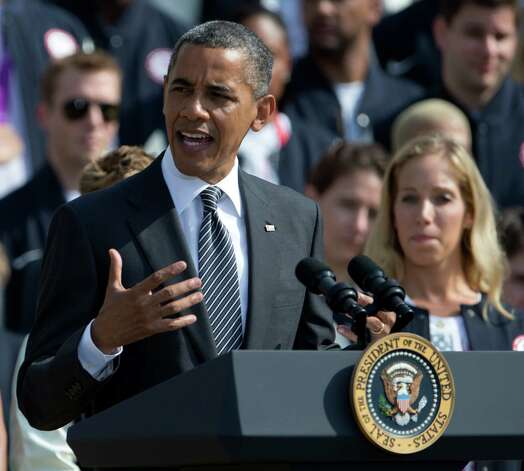 President Barack Obama speaks on the South Lawn of the White House in Washington, Friday, Sept. 14, 2012, during a ceremony to welcome the 2012 U.S. Olympic and Paralympic teams. (AP Photo/Carolyn Kaster) Photo: Carolyn Kaster, Associated Press / AP
