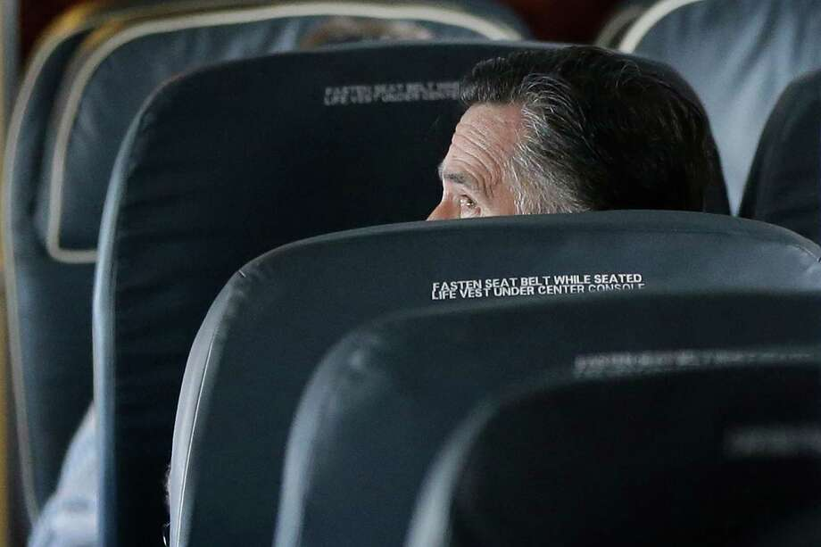 Republican presidential candidate and former Massachusetts Gov. Mitt Romney is seated on his campaign plane as it flies to Long Island, NY, Thursday, Sept. 13, 2012. (AP Photo/Charles Dharapak) Photo: Charles Dharapak, Associated Press / AP