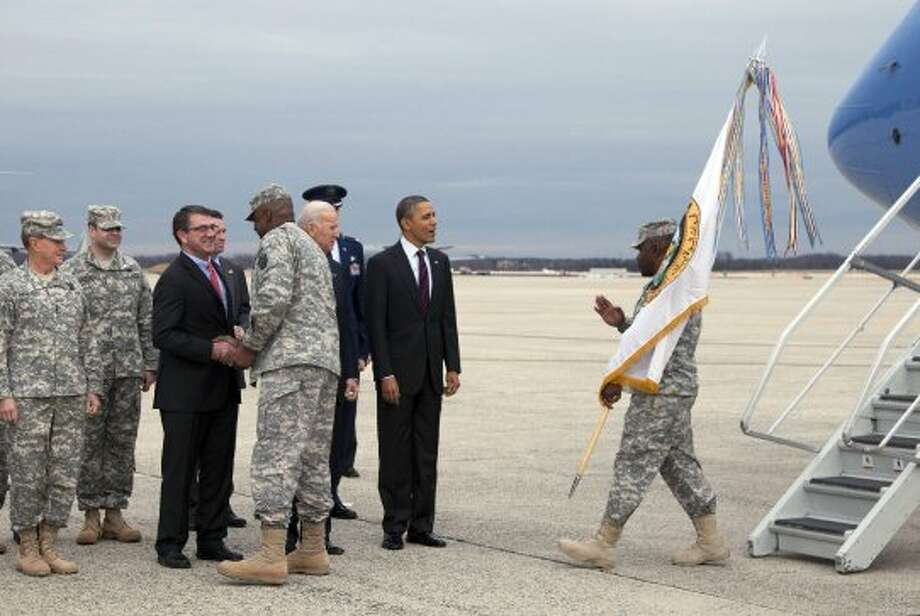Who: The commander-in-chief, President Obama, and returning soldiers. Where: Andrews (Md.) Air Force Base. When: Dec. 20, 2011.