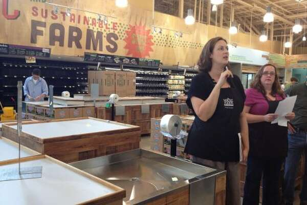 Rebecca Scofield leads the tour through the produce section at the newest Whole Foods Markets in San Antonio. (Jessica Elizarraras/San Antonio Express-News)