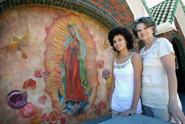 Toni Durr (right) and daughter Seneca Durr are proud of the mural of the Virgin of Guadalupe painted on the front of their home. Photo: Tom Reel, San Antonio Express-News / ©2012 San Antono Express-News